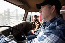 Male Farmer And Son Inside Truck