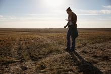Female Farmer Examining Soil I...