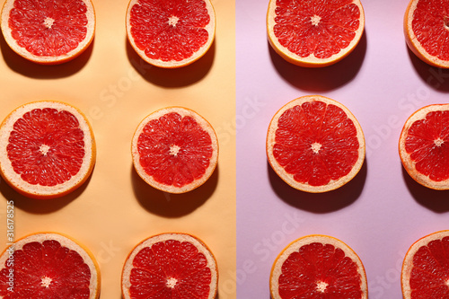 Fotomural  Flat lay composition with tasty ripe grapefruit slices on color background