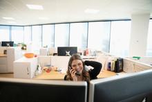 Happy Businesswoman Talking On...