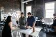 Creative business people meeting in open plan loft office
