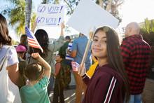 Portrait Confident Latinx Tween Girl Canvassing Voters With Neighbors