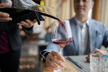 Sommelier Pouring Red Wine For...
