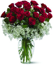 A Bouquet Of Red Roses In A Cl...