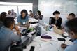 Millennial hackers working at laptops during hackathon