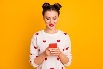 Fototapeta na wymiar Portrait of her she nice-looking glamorous attractive lovely pretty charming cute cheerful girl using device chatting with boyfriend isolated over bright vivid shine vibrant yellow color background