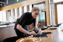 Waitress Folding Napkins, Setting Restaurant Table