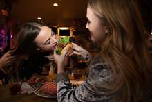 Women Friends Sharing Hamburge...