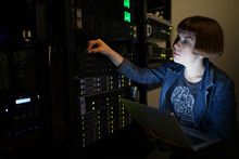 Female IT Technician With Lapt...