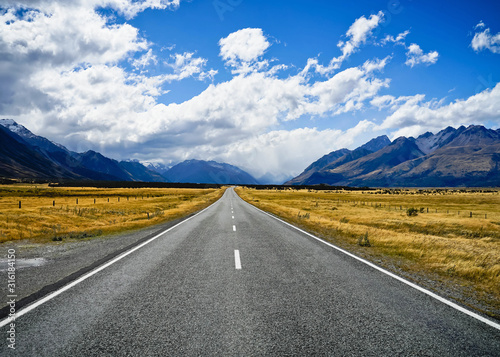 Fototapeta Concept of success way. Straight road to the north. Road with the mountain. obraz