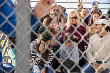 Baseball Fans In Bleachers Behind Fence