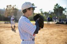 Focused Baseball Pitcher On Sunny Field
