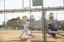 Baseball Player At Bat On Sunny Field