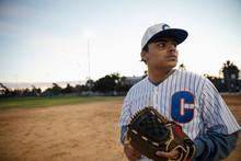 Latinx Baseball Player On Fiel...