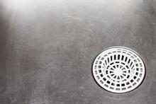 Metal Kitchen Sink. Plastic White Sieve Background.