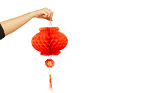 Happy Chinese New Year 2020. Female Hand Holding Red Lantern Isolated On White Studio Background. Celebration, Decoration, Holidays Concept. Copyspace For Your Ad.