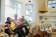 Happy Family Sitting On Sofa I...