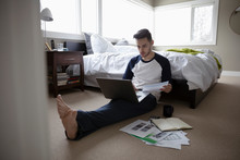Young Man Working From Home, U...