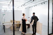 Gallery Owners Carrying Art, P...
