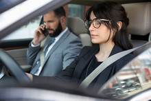 Business People Driving And Talking On Smart Phone