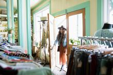 Woman Opening Door Of Vintage ...