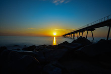 Sunrise Over The Beach With Th...