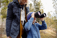 Mother And Son With Binoculars...