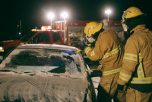 Firefighters Tending To Car Accident