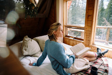 Serene Woman Reading Book On C...