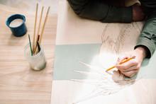 Male Artist Drawing Heron