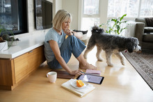Woman With Dog Working From Ho...