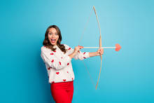 Portrait Of Her She Nice Attractive Lovely Pretty Amazed Astonished Cheerful Cheery Girl Shooting Arrow Amorous Goal Isolated On Bright Vivid Shine Vibrant Blue Color Background
