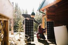 Couple Installing Solar Panels...