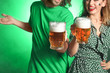 canvas print picture - Young couple with beer on color background. St. Patrick's Day celebration