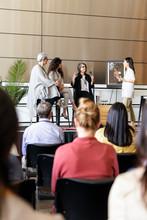 Female Panel Speakers On Stage...