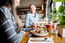 Women Friends Dining In Restau...