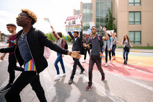 Group Of Students With Banners On Gay Pride March