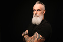 Portrait Confident, Tough Man With Gray Beard And Tattooed Arms