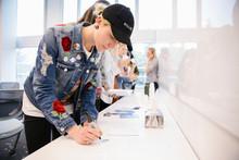 Student Wearing Denim Jacket A...