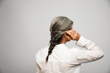 Rear View Portrait Woman With Gray Braid