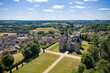 Leinwandbild Motiv aerial view of a french castle nearby an old village