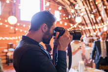 Male Photographer Working At Wedding Reception