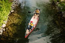 Overhead View Of Two Men Canoe...