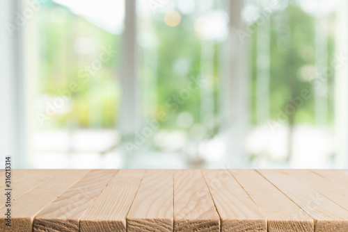 Obraz Empty wooden table and interior background, product display,blurred store with bokeh - fototapety do salonu