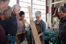 Mature Woman Teaching Woodwork...