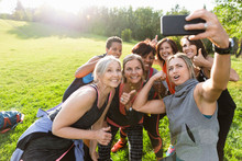 Group Of Women Taking Selfie On Smart Phone After Bootcamp