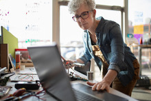 Mature Woman Using Laptop In Maker Space