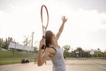 Mid Adult Woman Hitting Tennis Ball, Action Shot