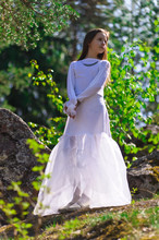Girl In White Dress In The Woods