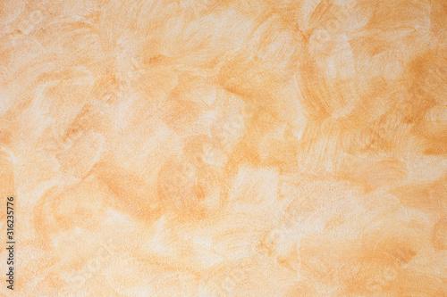 Obraz textura rugosa de pared pintada de naranja - fototapety do salonu